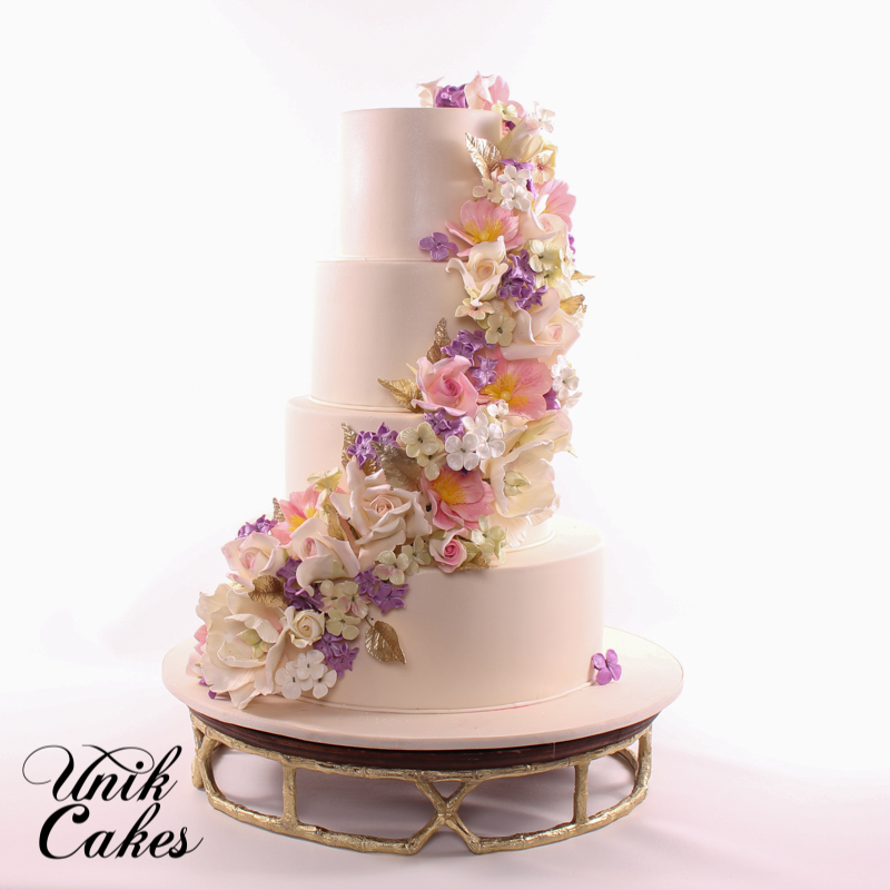 White wedding with cascading pastel sugar flowers