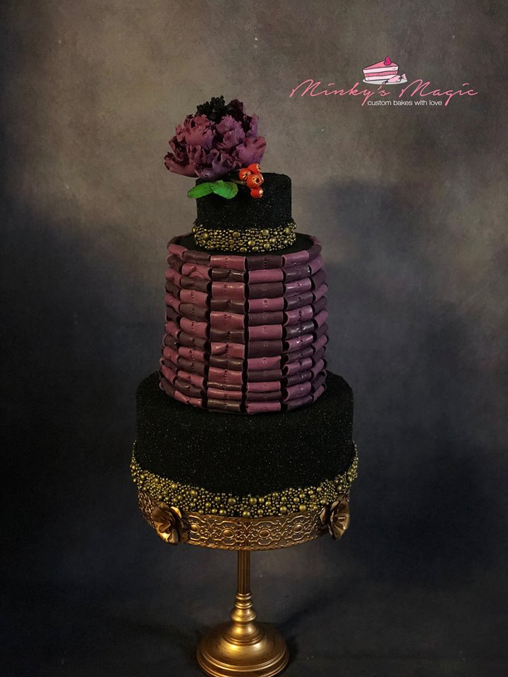 Black fondant cake with burgundy sugar flower