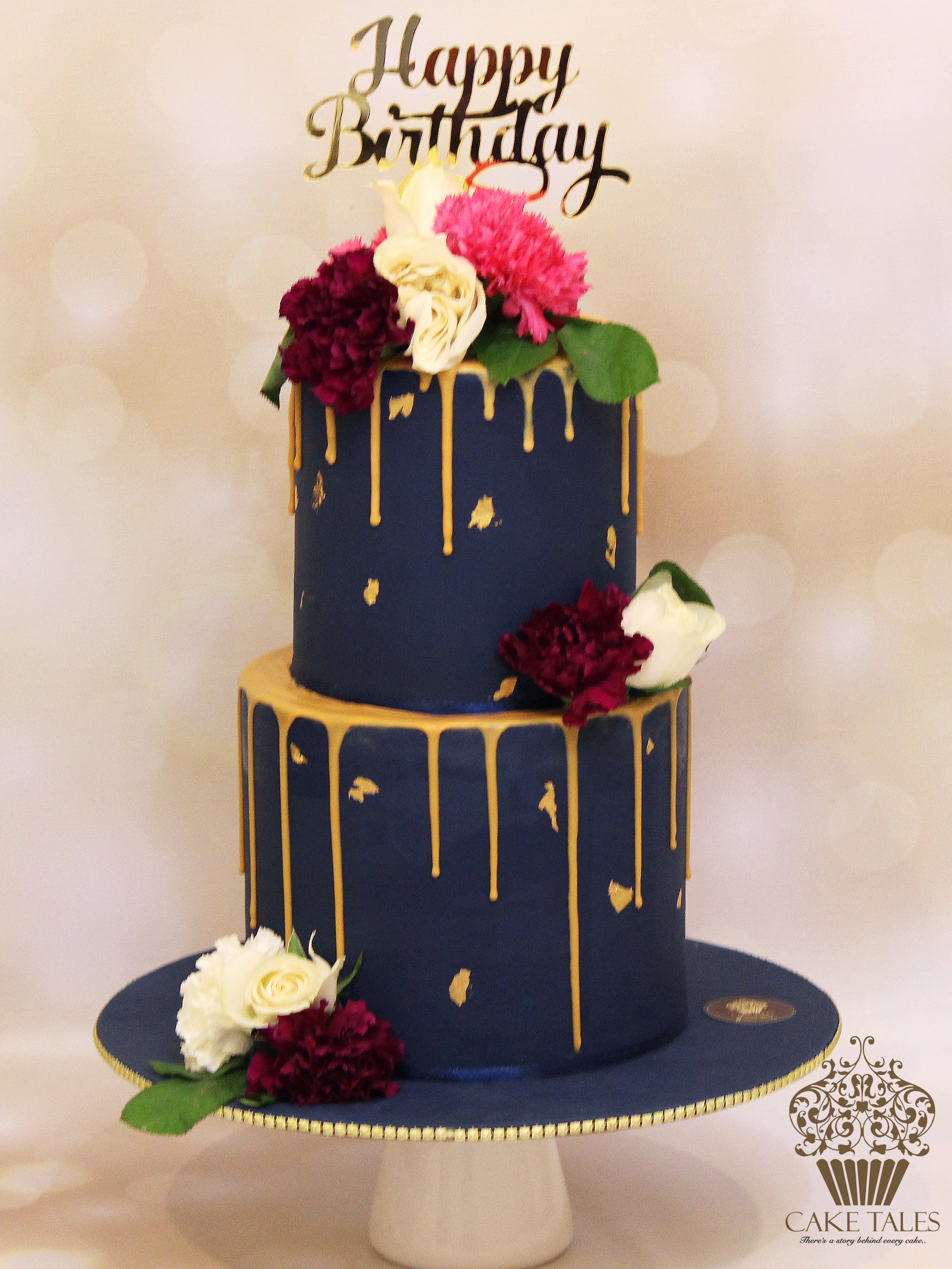 Navy with gold drip birthday cake