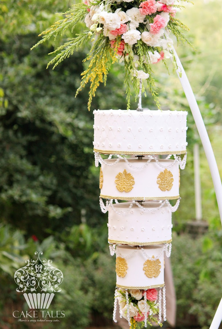 Hanging white and gold wedding cake