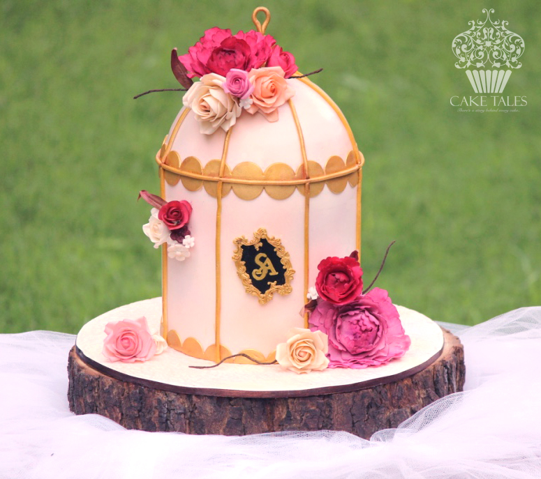 Pink birdcage wedding cake