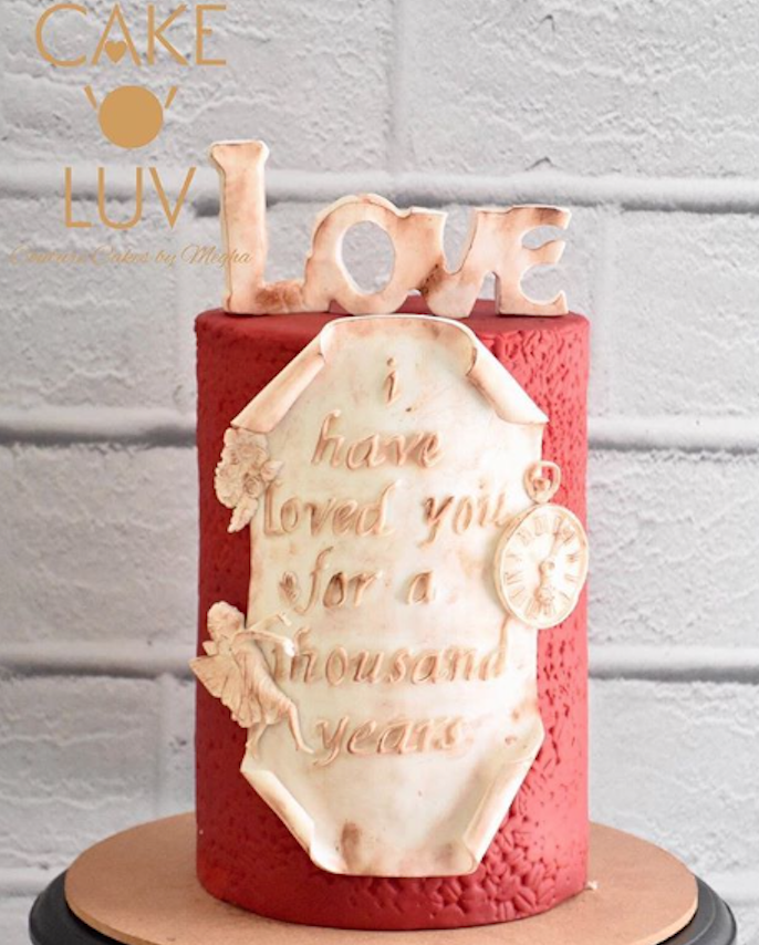 Red and white fondant cake with love topper