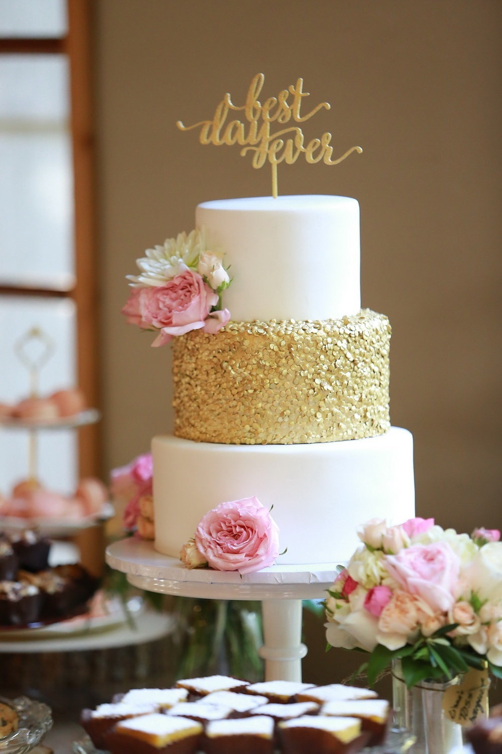 White fondant wedding cake with gold sequins