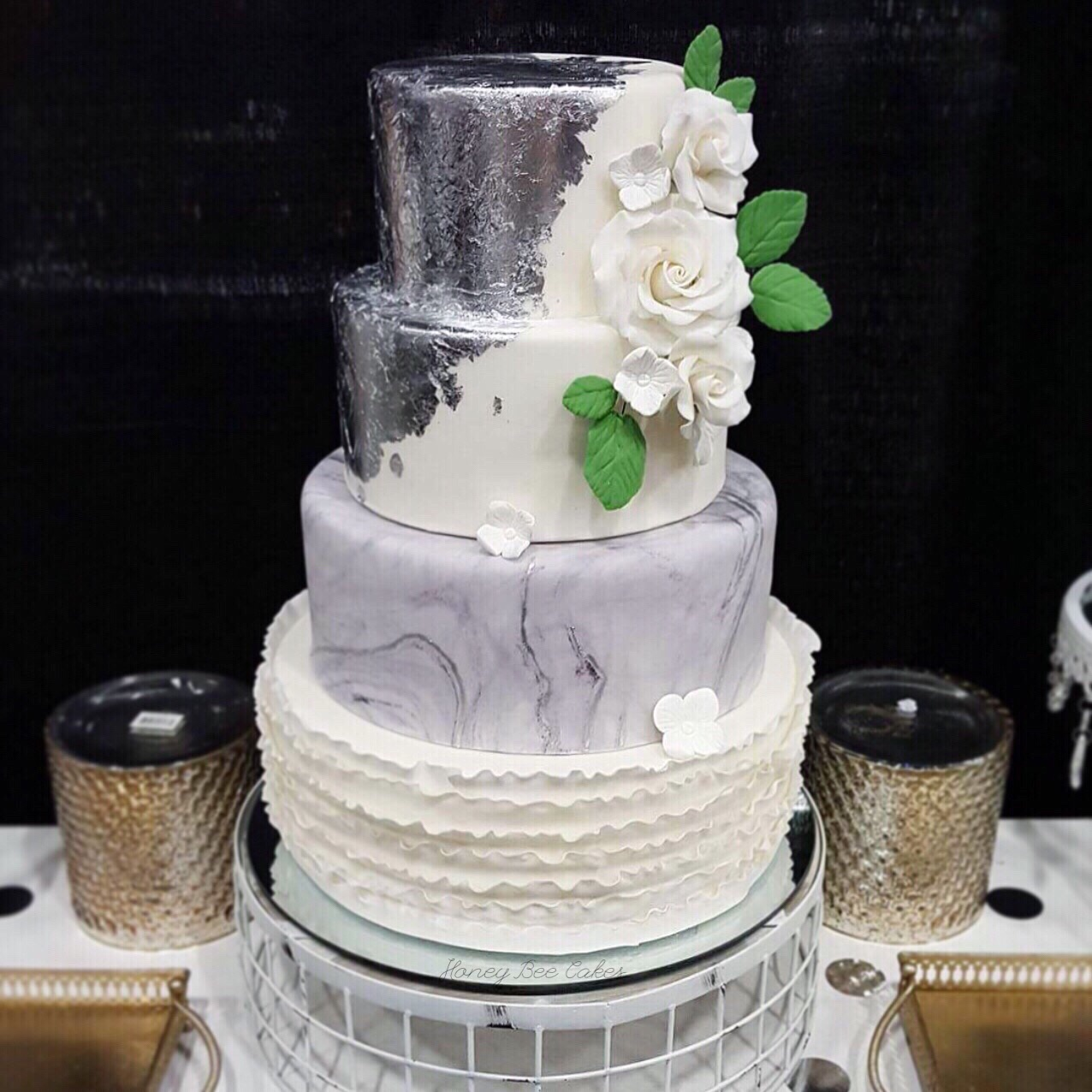 Gray and white ruffle wedding cake