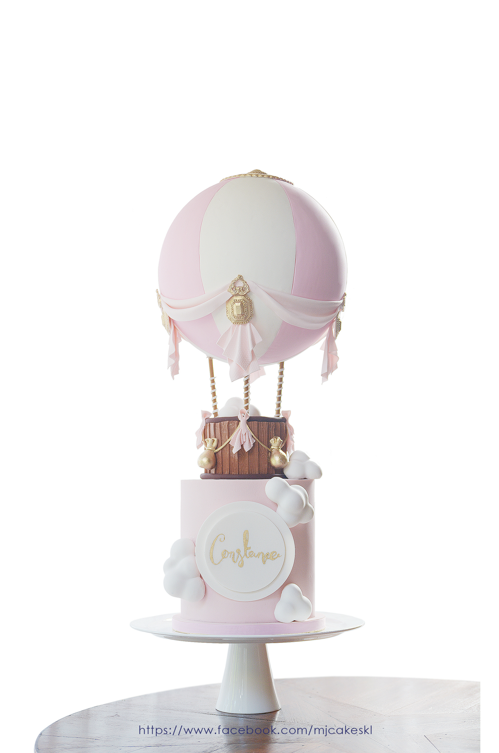 Pink and white hot air ballon fondant cake