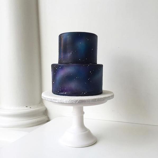 Navy blue starry night fondant wedding cake