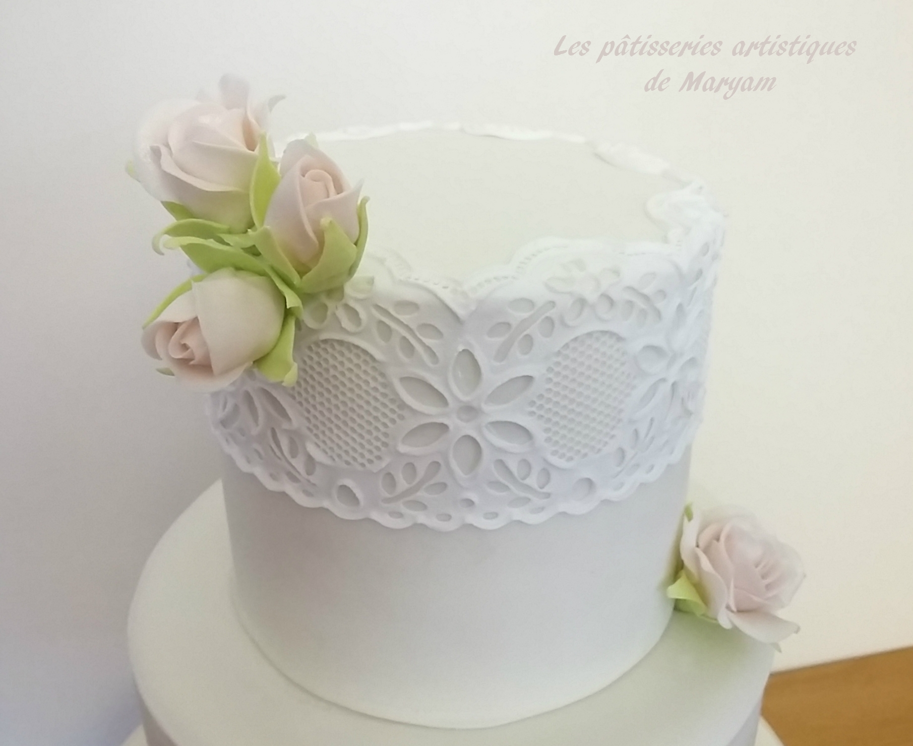 White sugar lace cake with sugar roses
