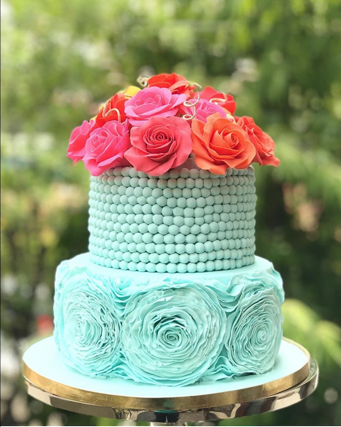 Turquoise fondant wedding cake with pink sugar flowers