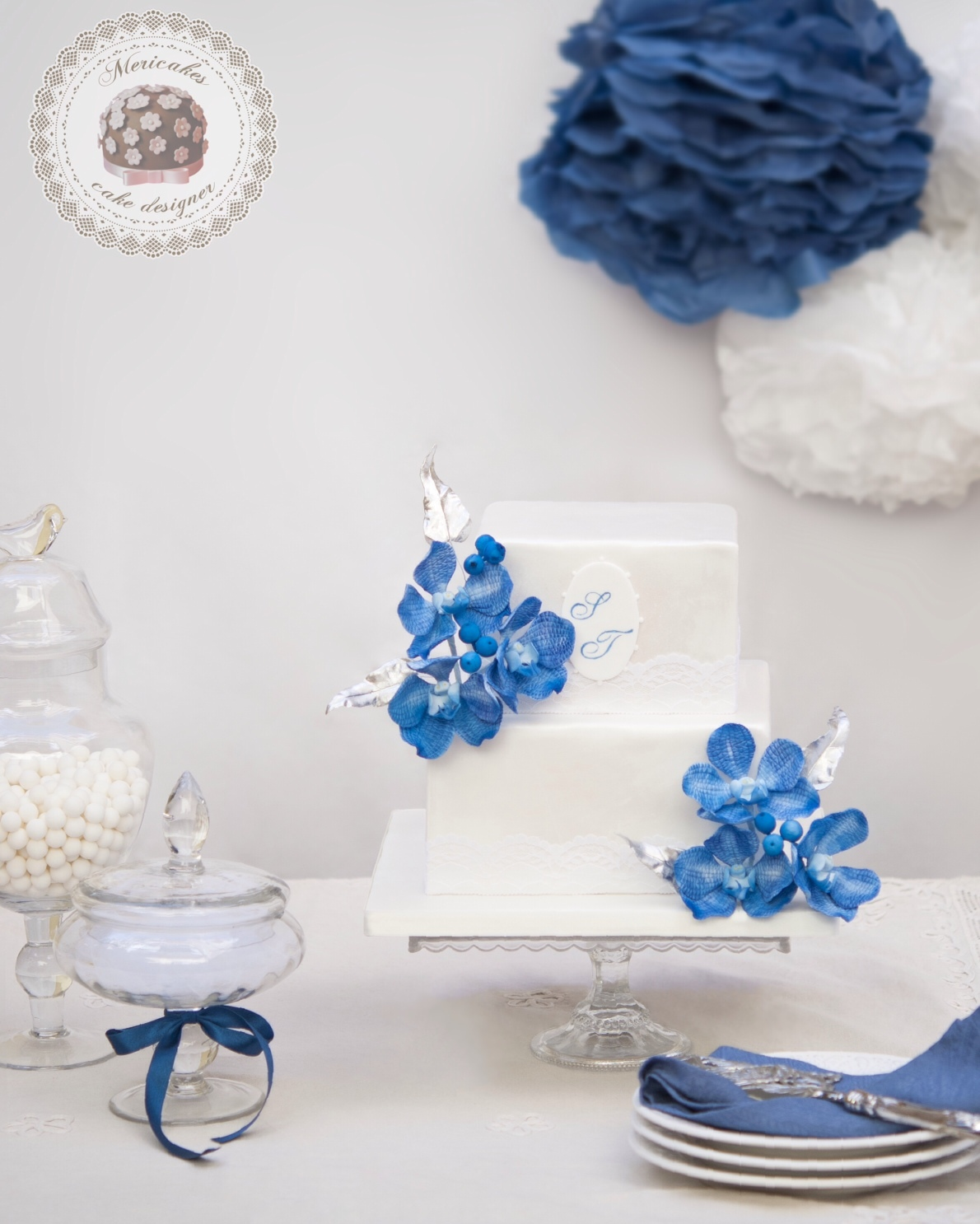 White fondant cake with blue sugar flowers