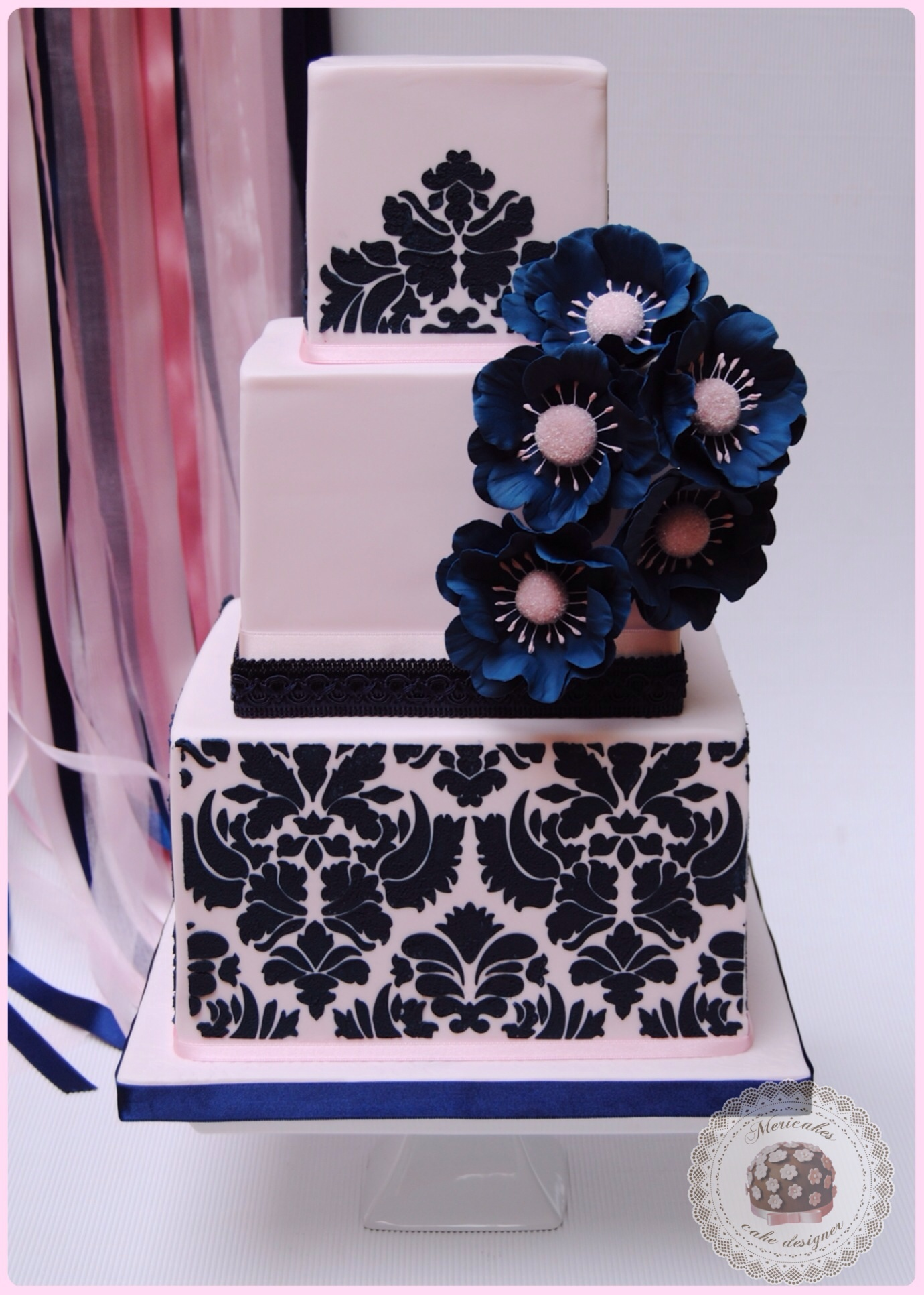 White fondant cake with navy blue sugar flowers