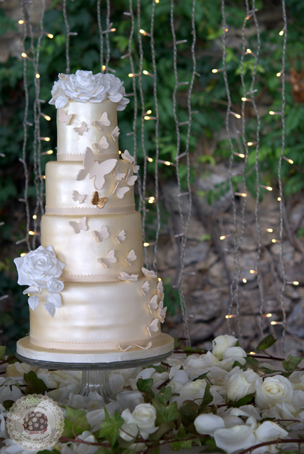 Shiny Ivory fondant wedding cake with butterflies