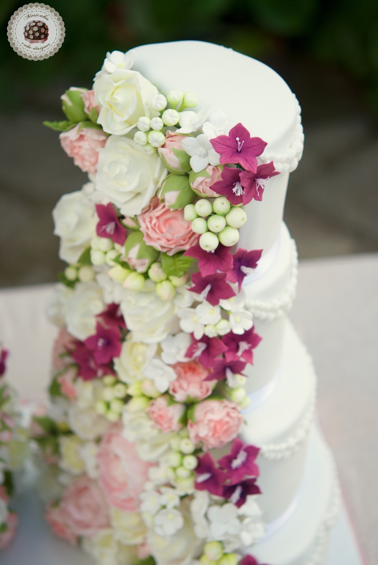 White wedding cake with sugar flower center