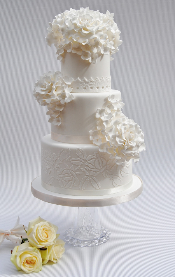 All White fondant Wedding cake with sugar flowers