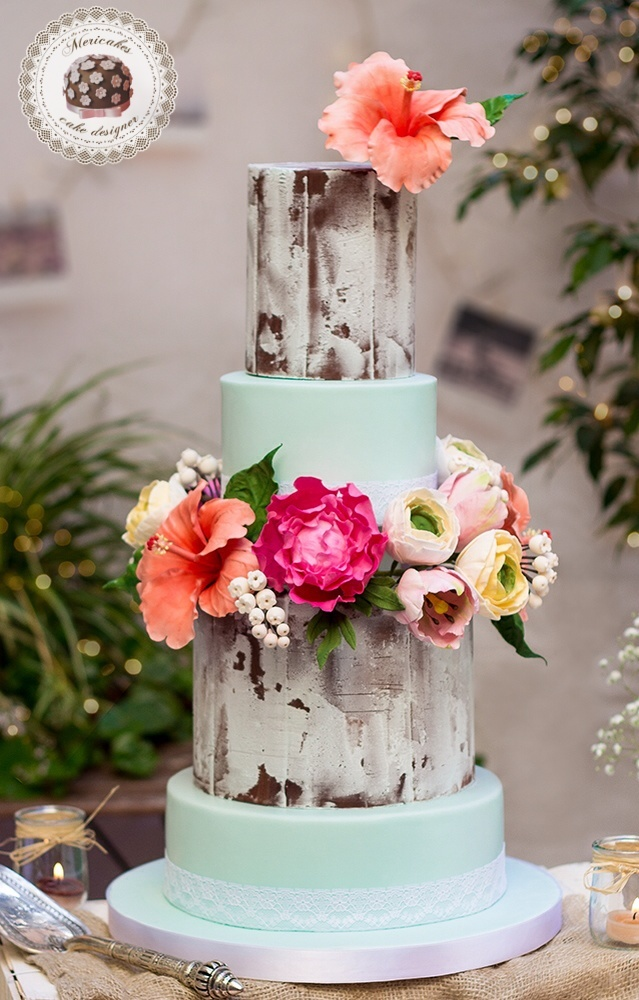 Rustic fondant wedding cake with turquoise