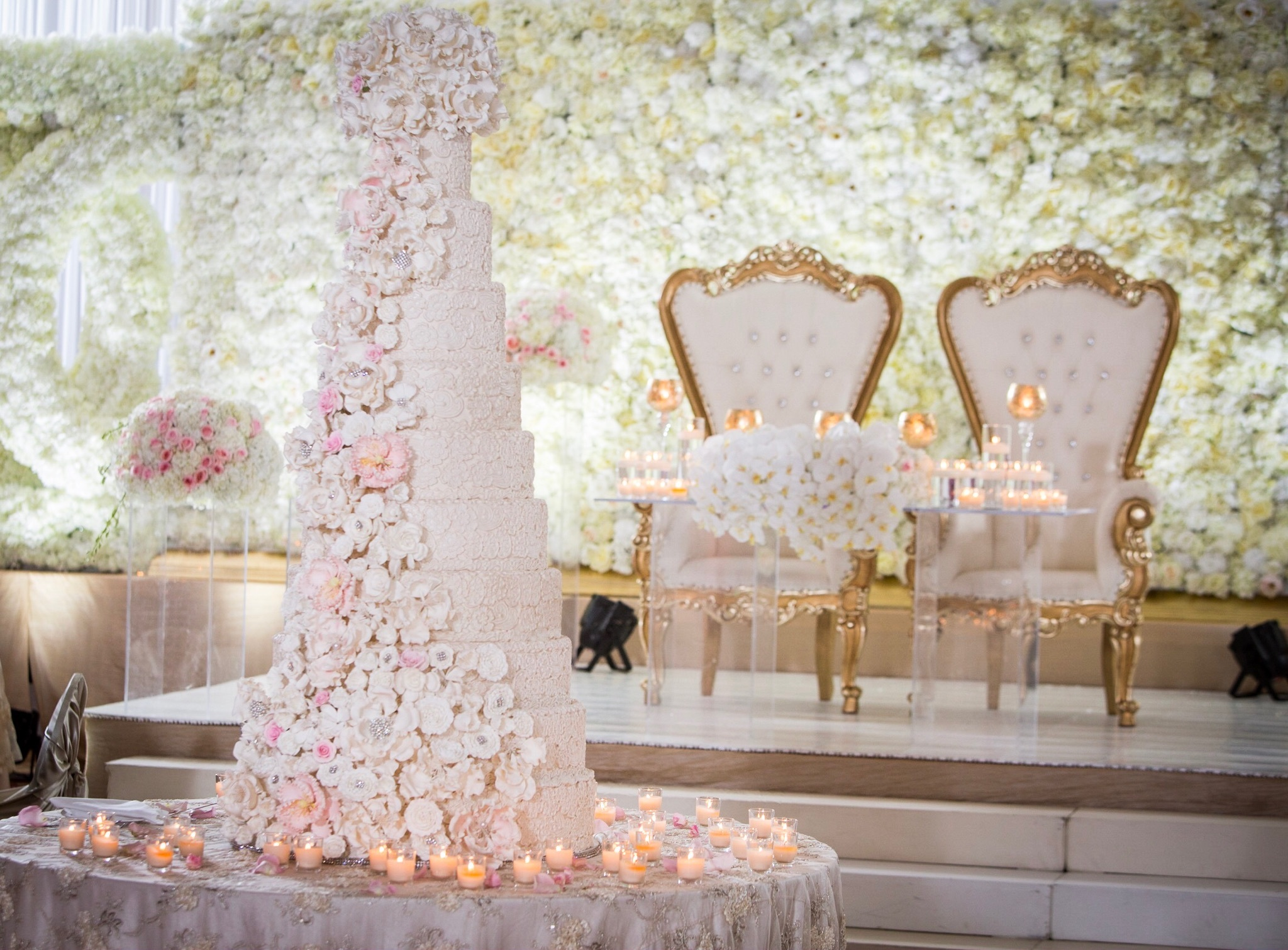 Tall white wedding with cascading sugar flowers