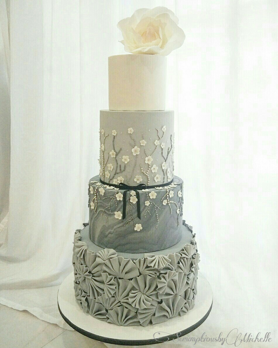 gray and white floral wedding cake with texture