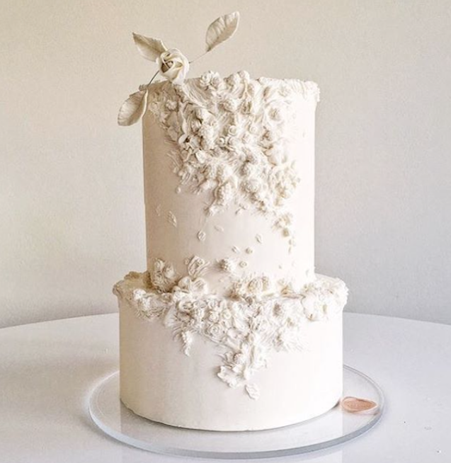 All Ivory fondant wedding cake with bas relief