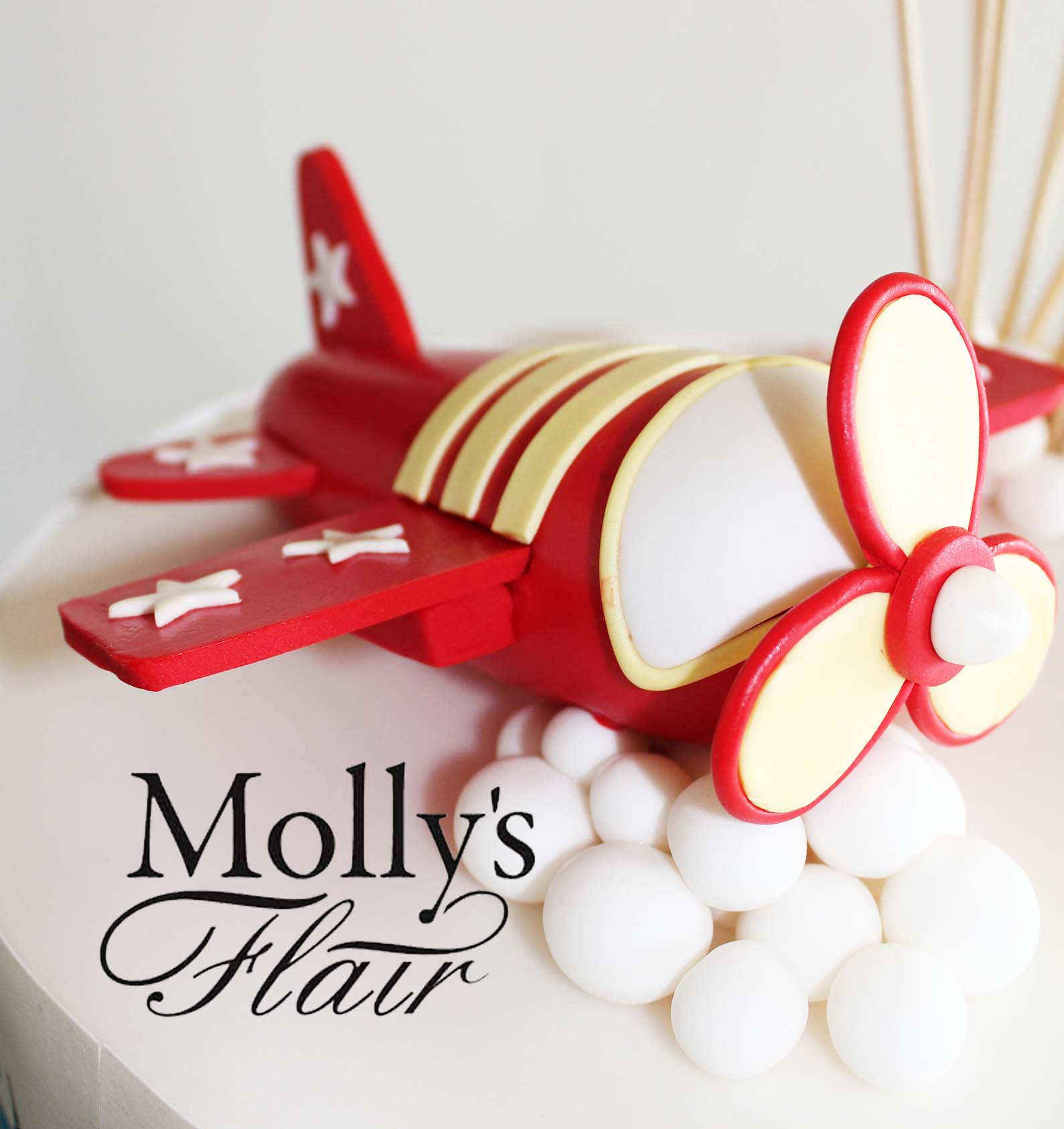 Red fondant airplane topper
