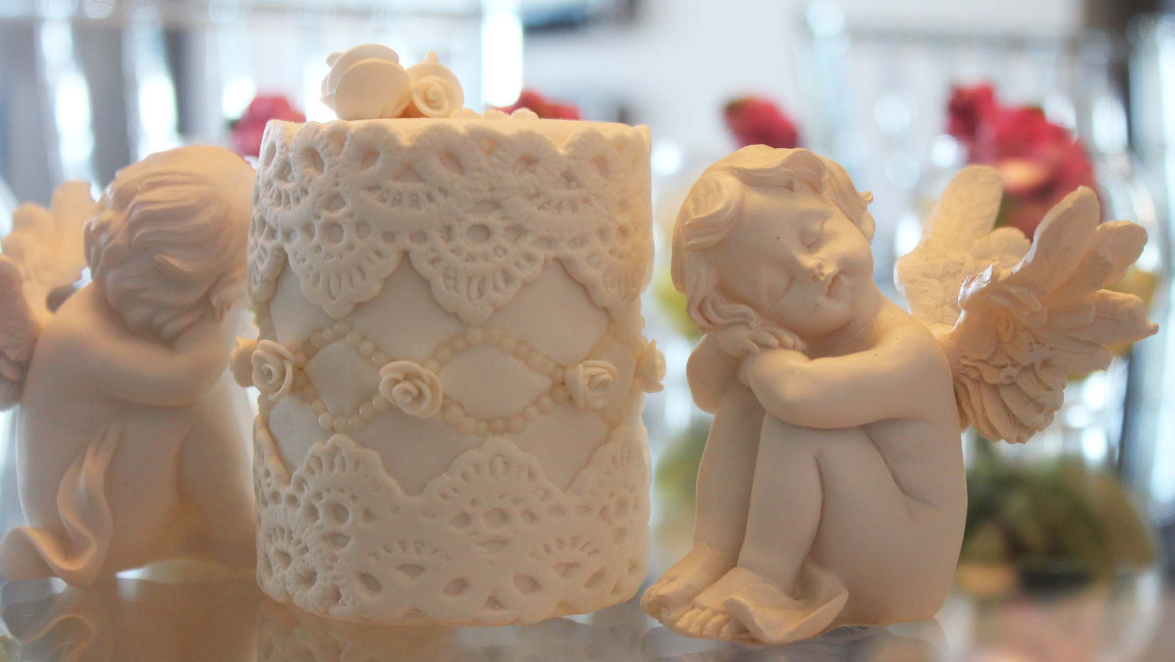 Mini white lace cake with angel figurines