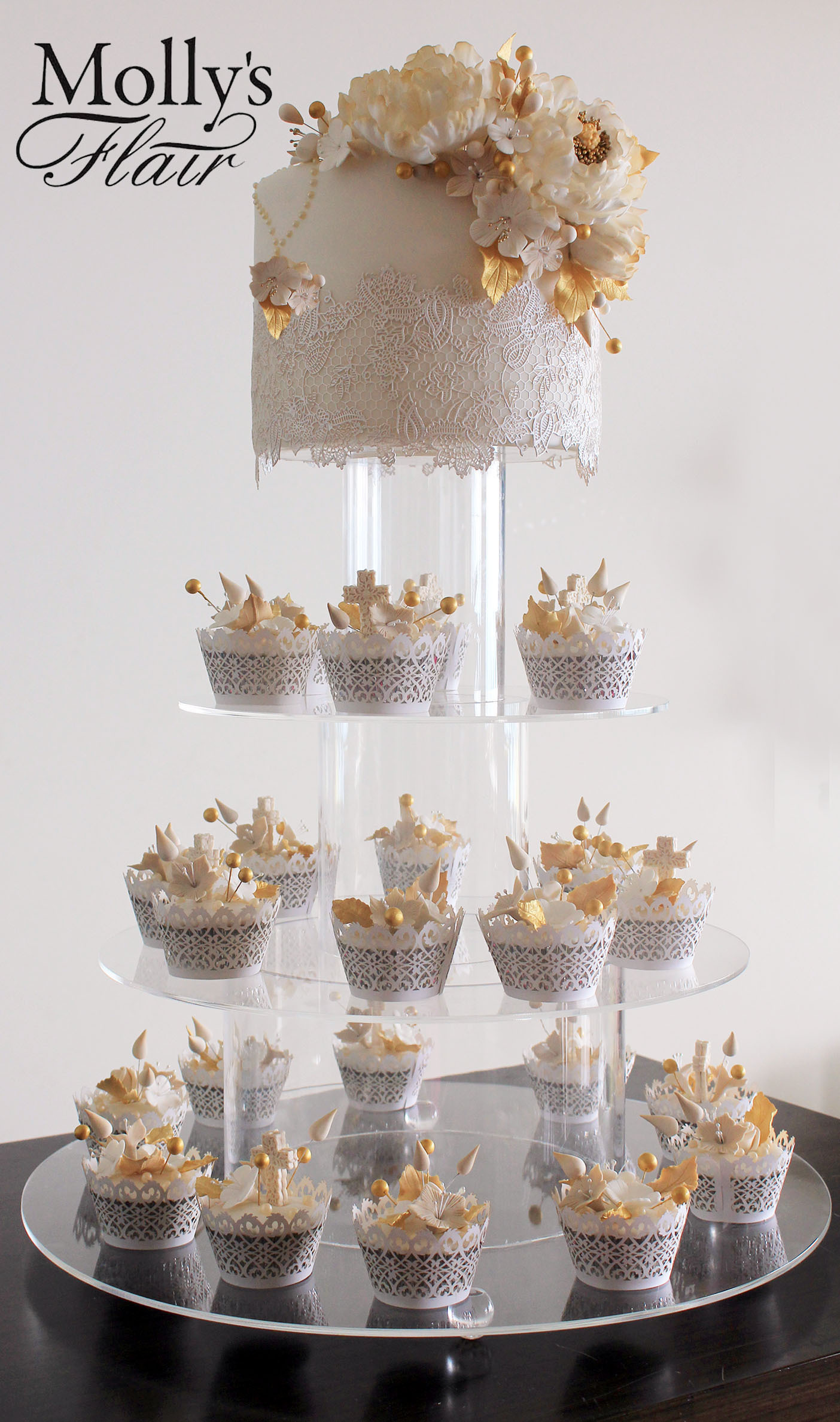 White mini wedding cake with cupcake tower