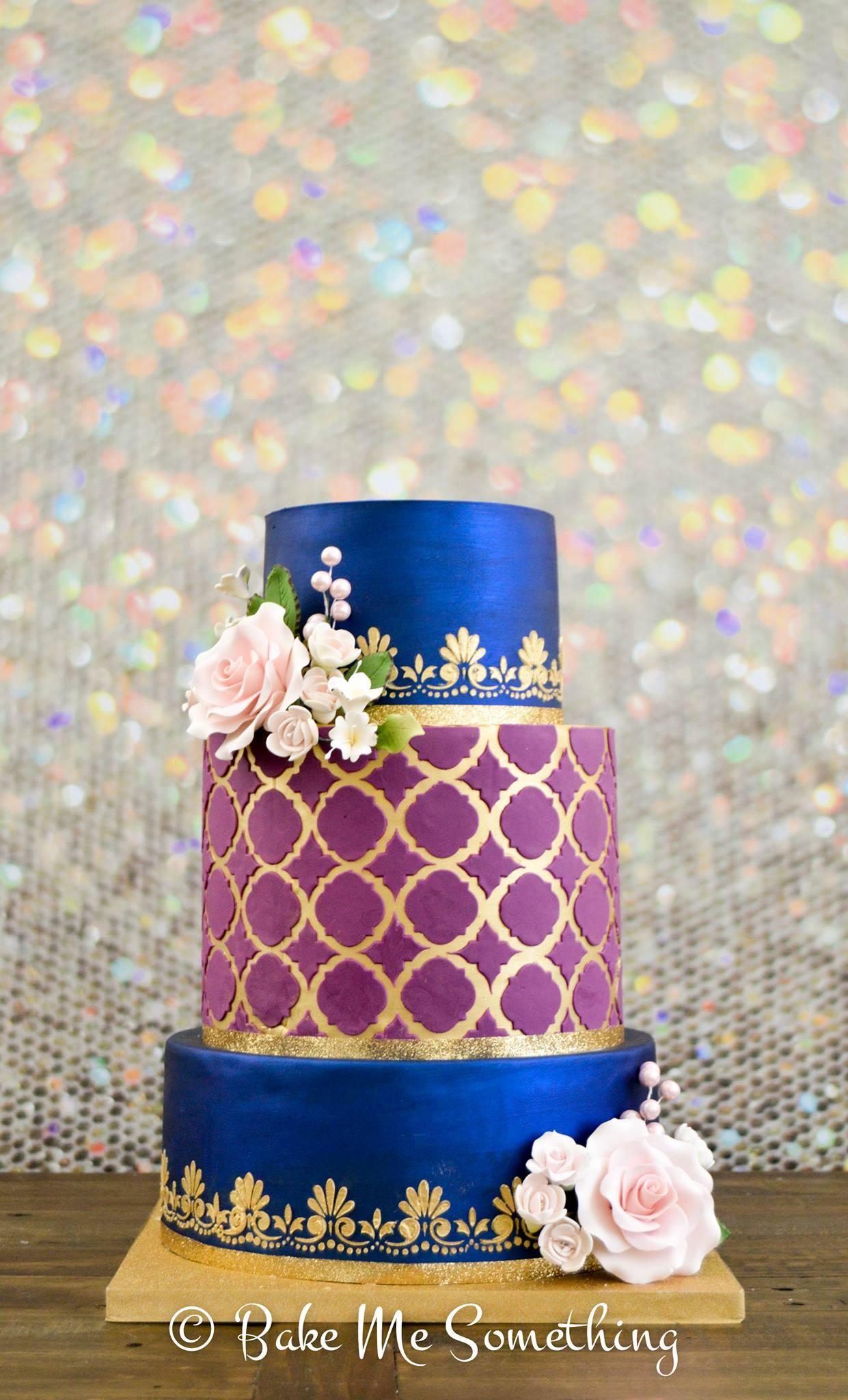 Burgundy and blue fondant wedding cake with gold accents