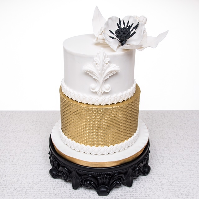 White fondant wedding cake with gold bottom
