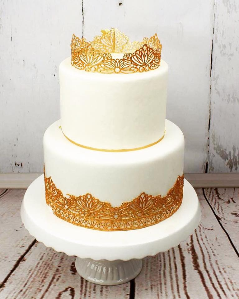 White wedding cake with gold crown