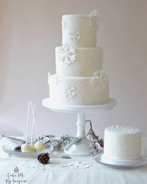 All white wedding cake with snowflakes