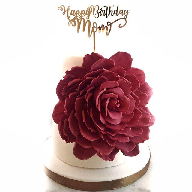 White birthday with large red sugar flower