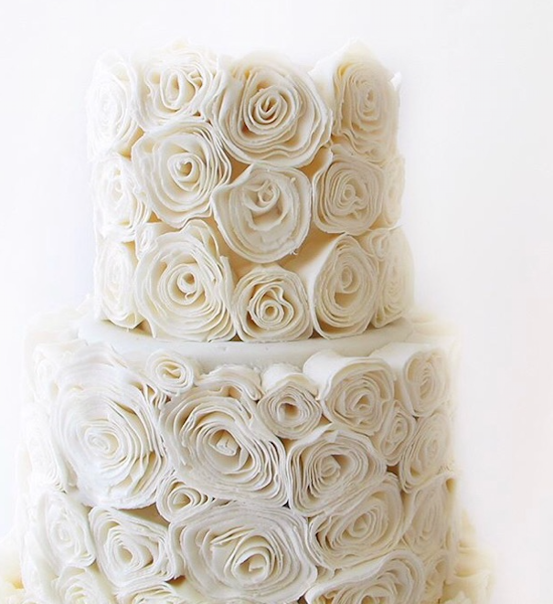 White textured fondant rosette wedding cake