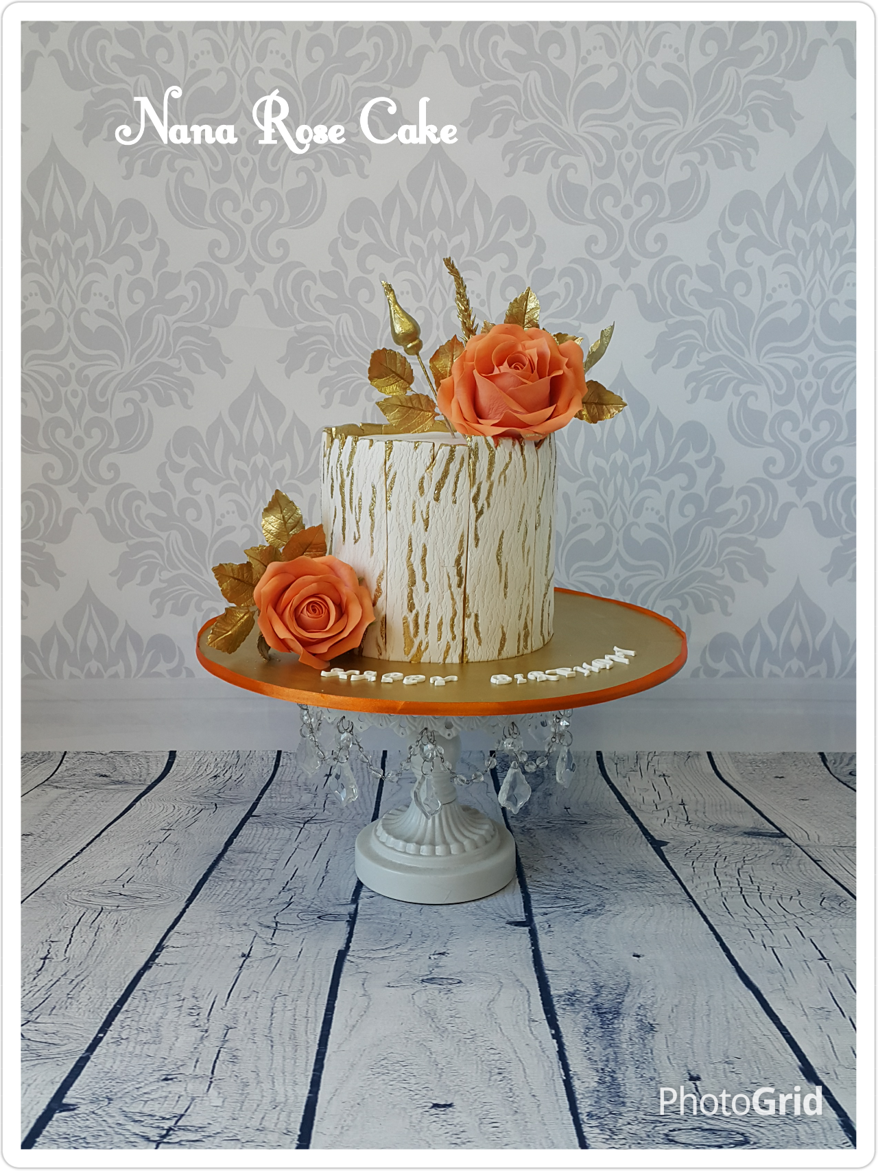 White fondant cake with orange sugar flowers