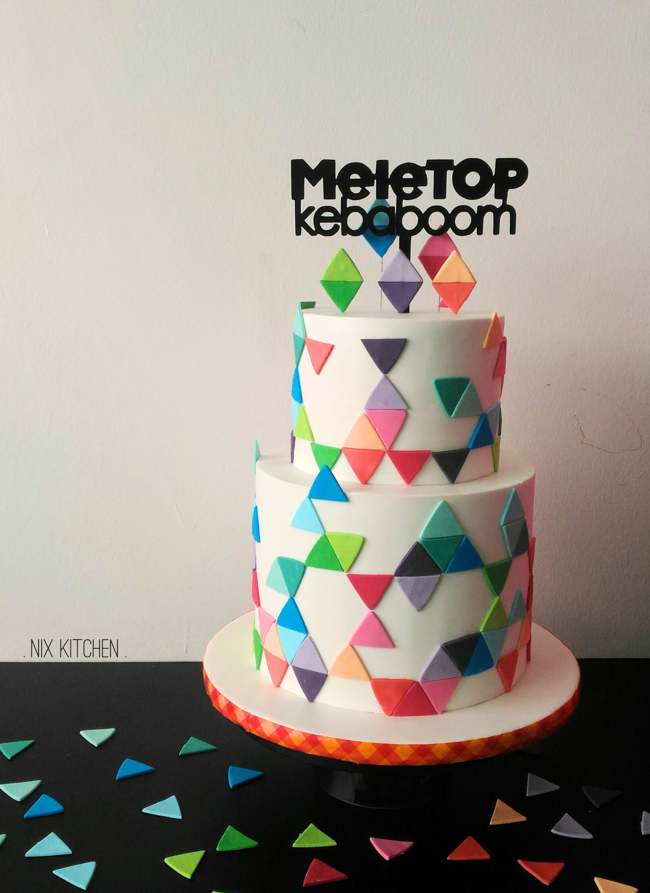 Colorful geometric patterned birthday cake