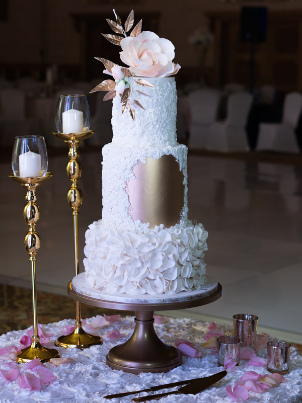 Rose gold fondant wedding cake with white ruffles
