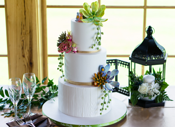 White vineyard themed wedding cake
