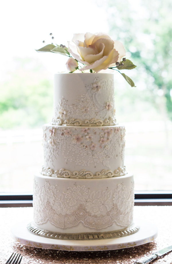 White wedding cake with bling and lace