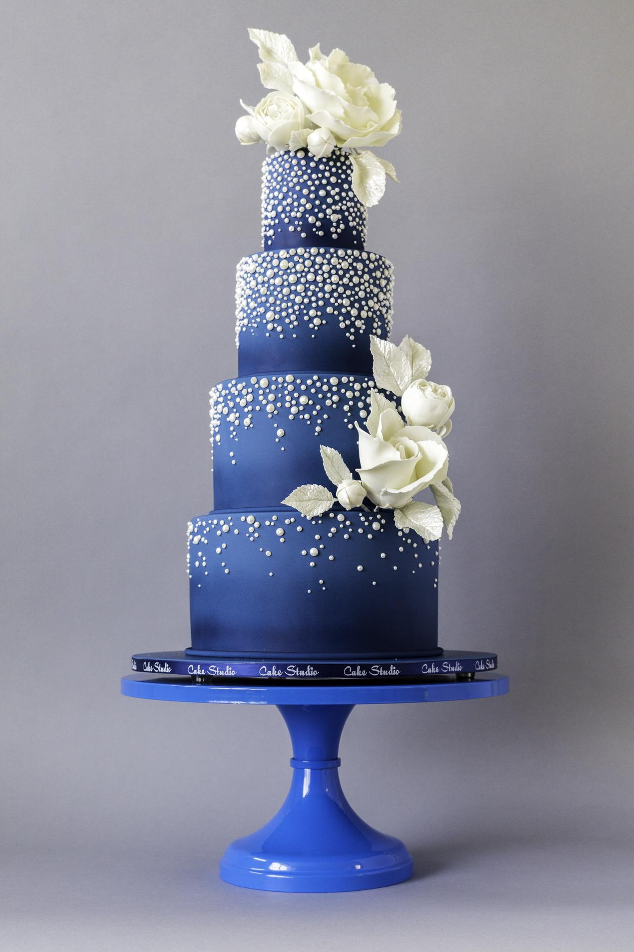 Midnight blue wedding cake with cascading sugar pearls
