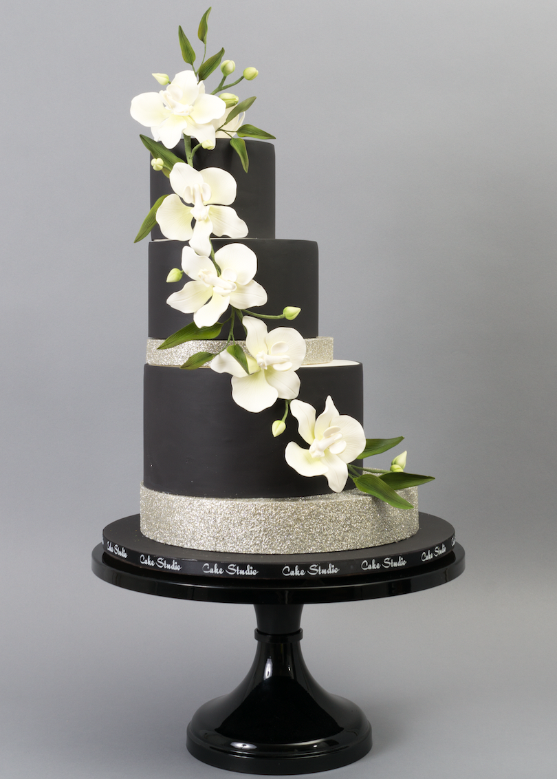 All black modern wedding cake with cascading white sugar flowers