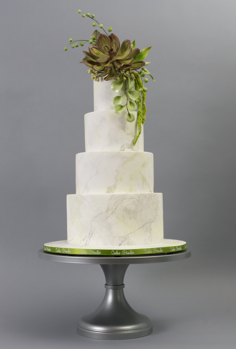 white fondant wedding cake with succulent topper