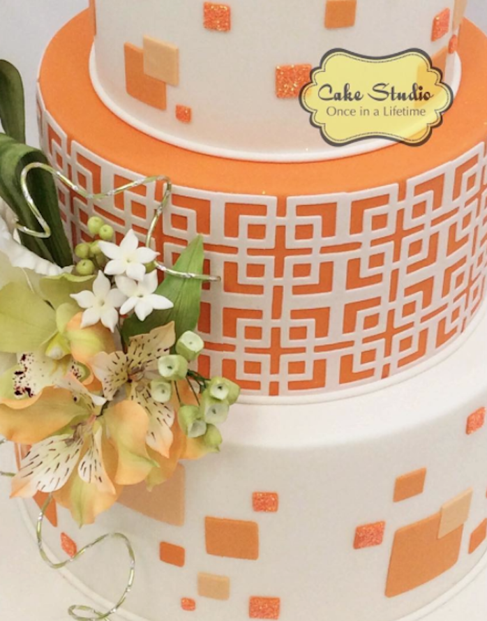 Orange and white patterned wedding cake
