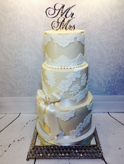Taupe and white fondant wedding cake with lace