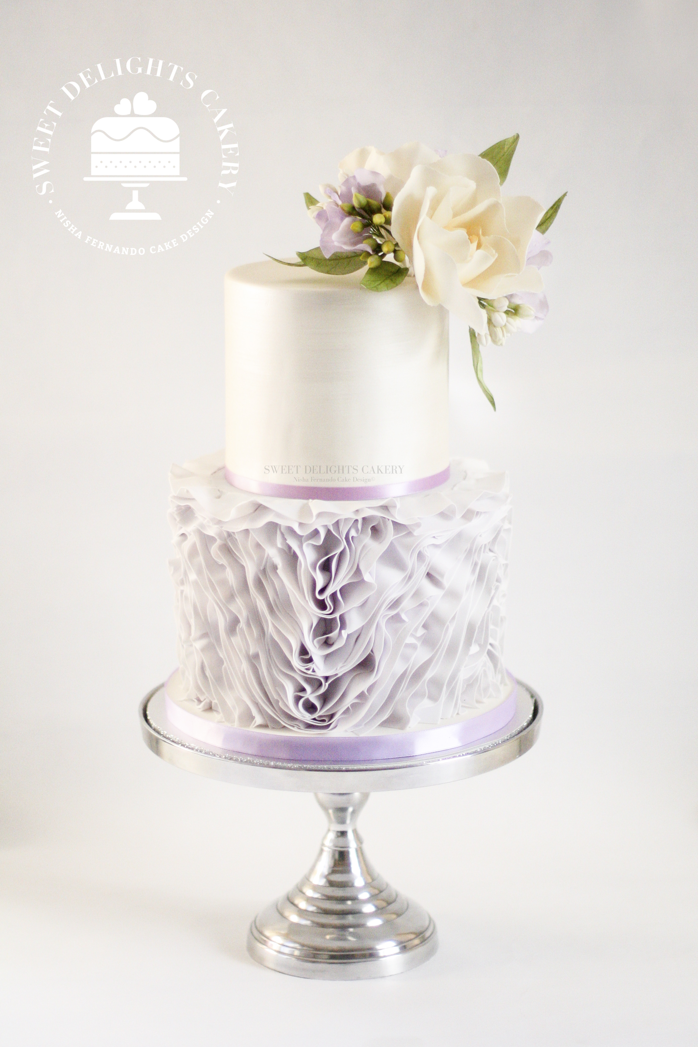 White fondant wedding with lavender ruffles