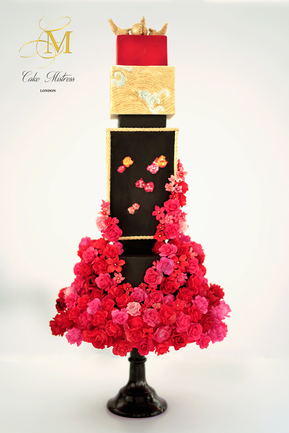 Black wedding cake with red sugar flowers