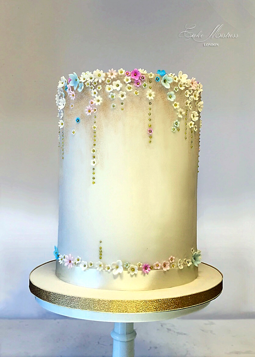 Gold barrel wedding cake