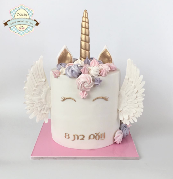 White unicorn fondant cake with wings