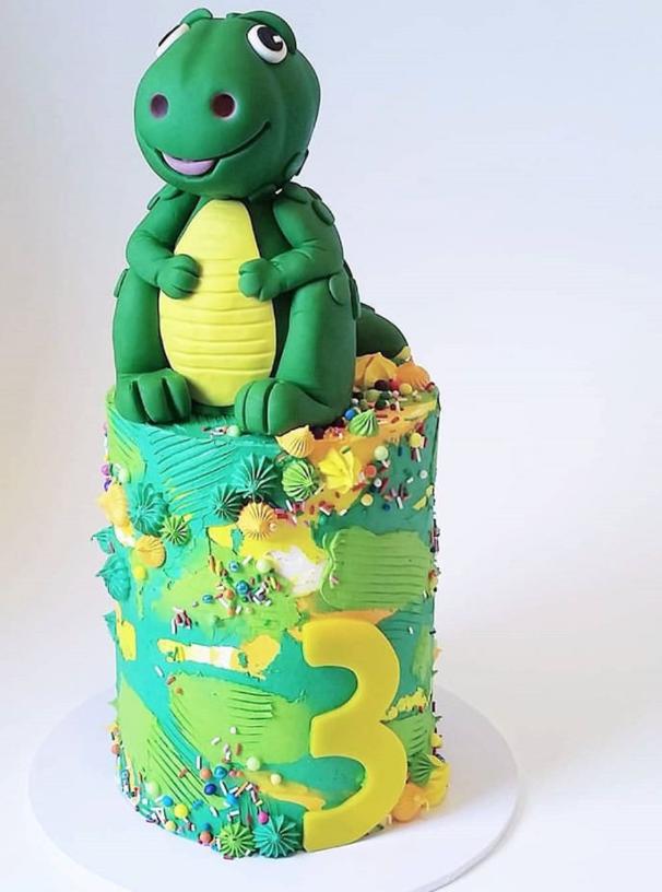 Green dinosaur fondant birthday cake
