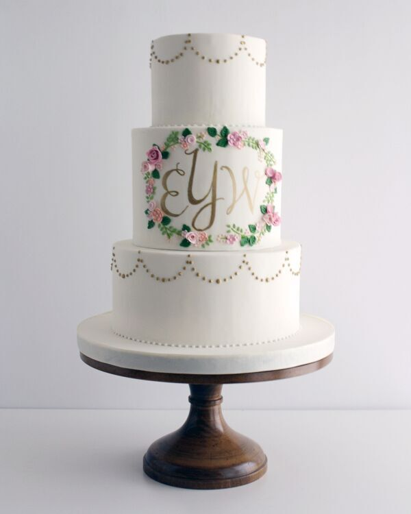 All white fondant wedding cake with center monogram