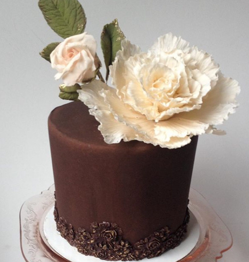 Brown fondant cake with big white sugar rose