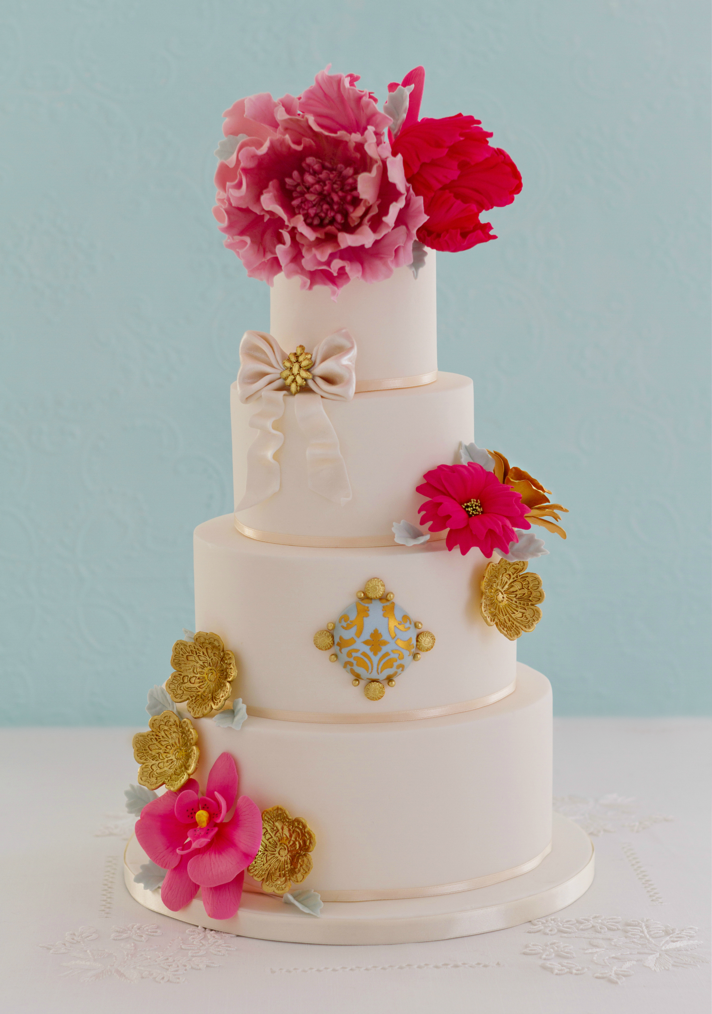 White Wedding with large pink sugar flowers