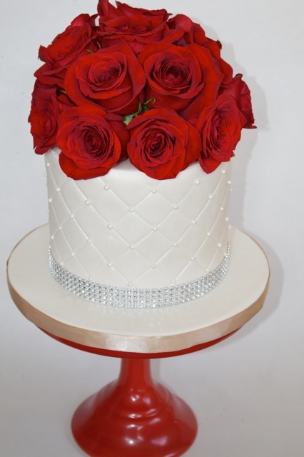 White fondant cake with red gum paste roses
