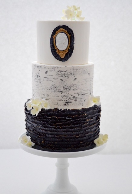 Black and white ruffle fondant wedding cake